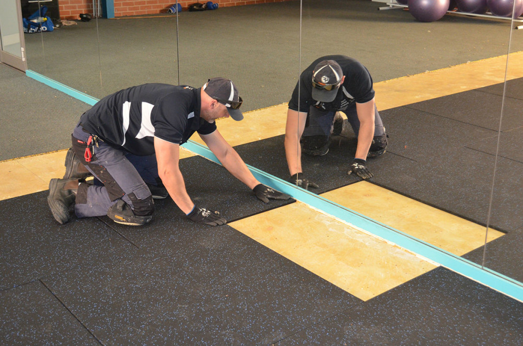 Panatta Staff laying custom Flooring